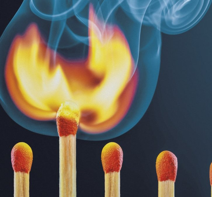 Row Of  Matchsticks With One Bursting Into Flames